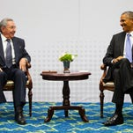 Cuban President Raul Castro, left, and U.S. President Obama meet at the Summit of the Americas in Panama City, Panama, on April 11, 2015.