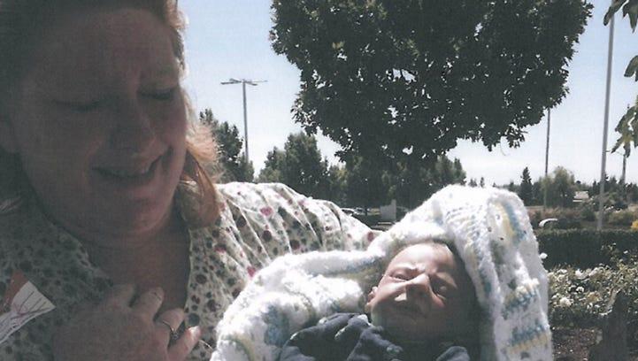 Tonya Whitney holding life-like baby doll