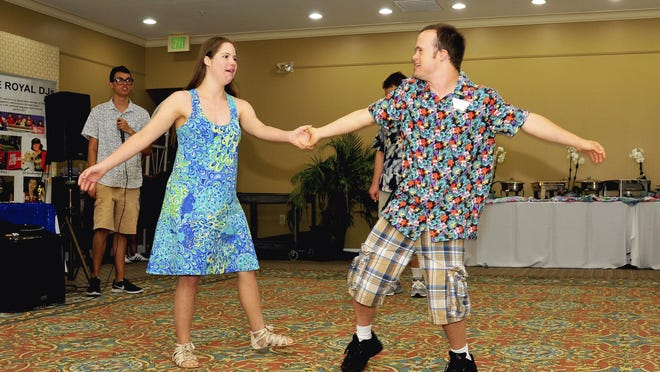 A couple dances during the Children's Health and Mentor Program's Hawaiian-themed luau last year at the National Croquet Center in West Palm Beach. The Jupiter-based agency works to organize free recreational activities for individuals with special needs.