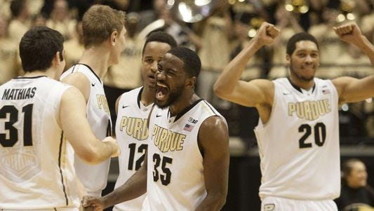 Purdue players celebrate their 66-61 victory over North Carolina State on Dec 2. That win has helped the Boilermakers' NCAA candidacy, especially as the Wolfpack has played better in recent weeks.
