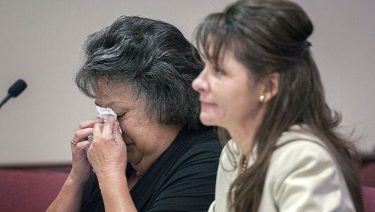 Former New Mexico Secretary of State Dianna Duran, left, reacts next her attorney, Erlinda Johnson, after speaking to the court during a sentencing hearing in Santa Fe.