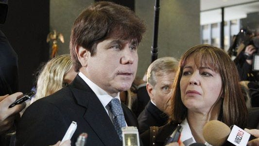 In this Dec. 7, 2011 file photo, former Illinois Gov. Rod Blagojevich speaks to reporters as his wife, Patti, listens at the federal building in Chicago, after Blagojevich was sentenced to 14 years on 18 corruption counts.