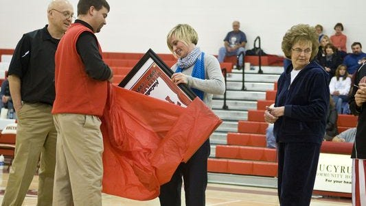 Natalie Winkelfoos, Bucyrus High School class of 1999, was inducted into the first Bucyrus City Schools Hall of Fame class for her career and achievement as the first Bucyrus basketball player to score one thousand points in a career.