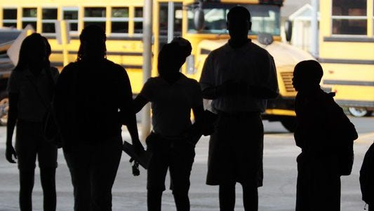 Students wait for the bus at a Louisiana middle school.