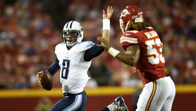 Titans quarterback Marcus Mariota (8) scrambles away from Chiefs outside linebacker Ramik Wilson (53) during the second quarter at Arrowhead Stadium Friday Aug. 28, 2015, in Kansas City, Mo.