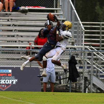 Wakulla's Kelton Donaldson goes up for a catch against