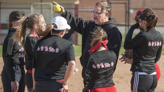Kingsway softball coach Tony Barchuk instructs his players during a practice at Kingsway High School on Monday, March 28. Barchuk will retire from coaching and teaching at the end of the school year.