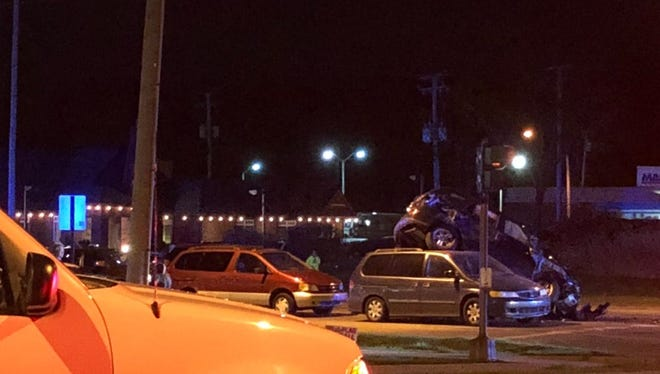 Police said only one person was injured after a vehicle went airborne and collided with seven other vehicles Thursday, April 26, 2018 in East Lansing.