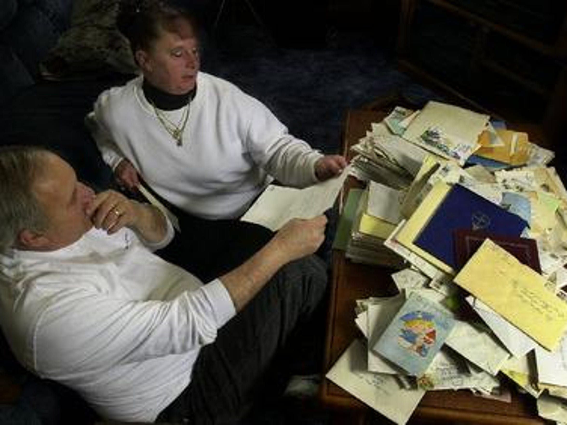 In this 2004 photo, David and Jean Lindsey in their Binghamton home read through the thousands of letters and cards they received after their daughter Cheri's murder 20 years earlier.