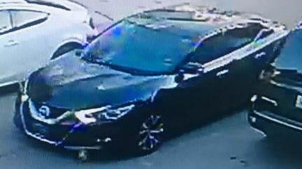 A photo of the Nissan that police say the gunman used to drive from the scene.