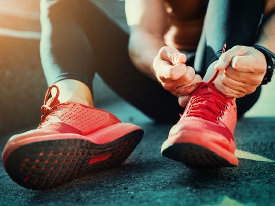 Runner putting shoes on.