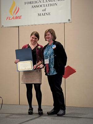 Stephanie Carbonneau, left, receives the Teacher of the Year Award from Foreign Language Association of Maine (FLAME) President Emily Bowen at the FLAME conference on March 6, 2020.