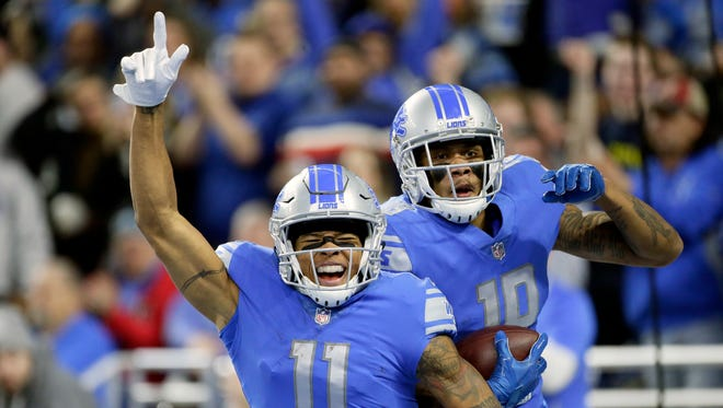 Lions receivers Marvin Jones (11) and Kenny Golladay celebrate Golladay's 54-yard touchdown in the second quarter against the Packers on Sunday at Ford Field.