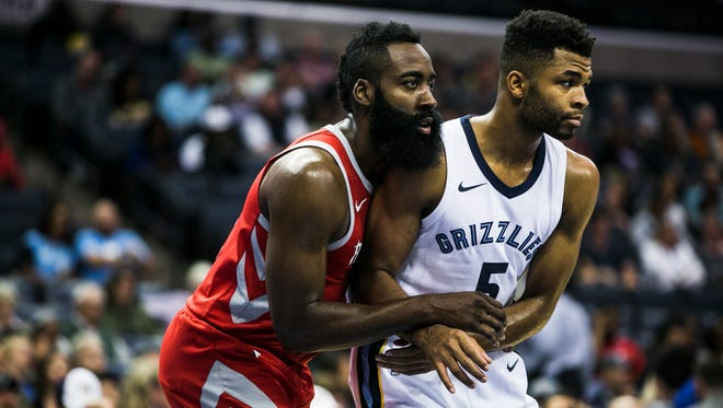 October 11, 2017 - Houston Rockets guard James Harden wraps himself up with Memphis Grizzlies guard Andrew Harrison during free throws in the first quarter at FedExForum on Wednesday night.