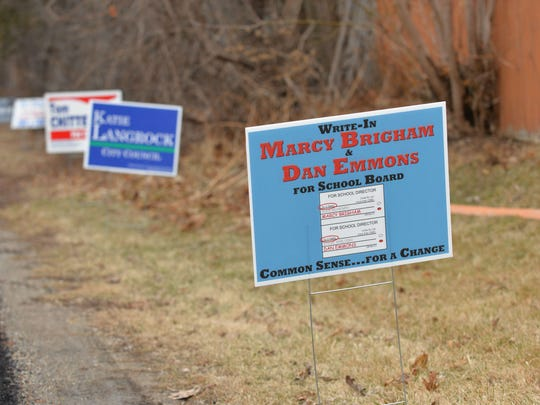 A sign along the drive to Orchard School in South Burlington urges voters to support write-in candidates for the School Board Marcy Brigham and Dan Emmons on Town Meeting Day, March 7, 2017.