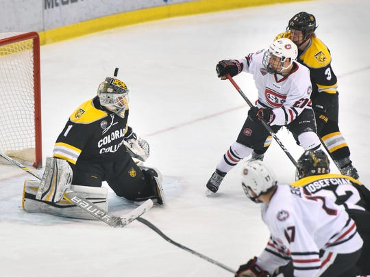 The puck goes just over the head of Colorado College goaltender Alex Leclerc during the first period of the Friday, Nov. 17, game at the Herb Brooks National Hockey Center in St. Cloud.