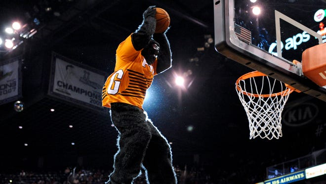 The Suns mascot the Gorilla dunks the ball during the fourth quarter against the Los Angeles Clippers at US Airways Center.