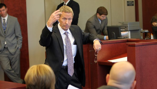 Oct. 25, 2012 Wil Zevely, attorney for  Shayna Hubers, charged in the shooting death of Ryan Poston,  questions  Highland Heights Police detective Bill Birkenhauer in  Campbell District Court during a preliminary hearing.