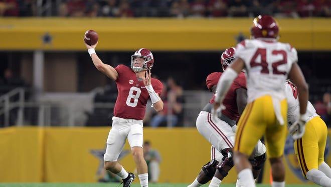 Alabama Crimson Tide quarterback Blake Barnett (8) throws a 45-yard touchdown pass against the USC Trojans during an NCAA football game at AT&T Stadium.