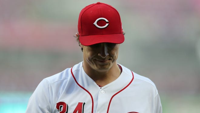 Cincinnati Reds starting pitcher Homer Bailey (34) walks back to the dugout in the third inning during a National League baseball game between the New York Mets and the Cincinnati Reds, Monday, May 7, 2018, at Great American Ball Park in Cincinnati.