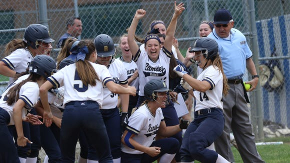 Victoria Sebastian, of Ramsey, heads to home plate where  her teammates are waiting after she hit a solo home-run to start the game. Monday, May 28, 2018