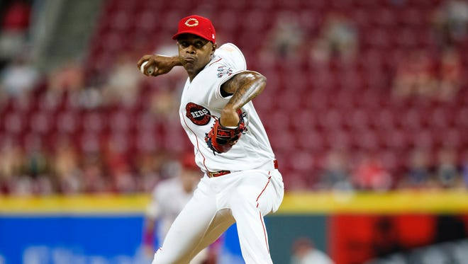 Cincinnati Reds relief pitcher Raisel Iglesias (26) delivers a pitch in the top of the ninth inning of the MLB Interleague game between the Cincinnati Reds and the Chicago White Sox at Great American Ball Park in downtown Cincinnati on Monday, July 2, 2018. The Reds won 5-3 after an eighth inning comeback.