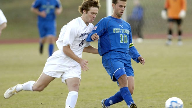 The University of West Florida's Felipe Lawall is pressured by Montevallo's Chris Stanfield Friday during the 2006 NCAA Division II Men's Soccer Championship at the University of West Florida. Lawall is one of many former Argos playing for the Gulf Coast Texans in the Amateur Elite Gulf Coast Premier League this season.
