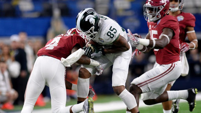 MSU's Macgarrett Kings Jr., makes a reception in the first half of the 80th Annual Cotton Bowl Classic between Michigan State and Alabama Thursday, December 30, 2015 in Arlington, Texas.