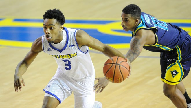 Delaware's Anthony Mosley (3) scored 23 points Thursday as the Blue Hens lost their 14th straight game.