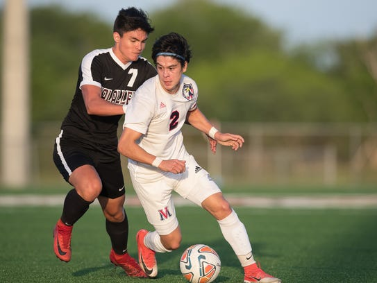 Veterans Memorial Karlo Lopez drives that ball up the