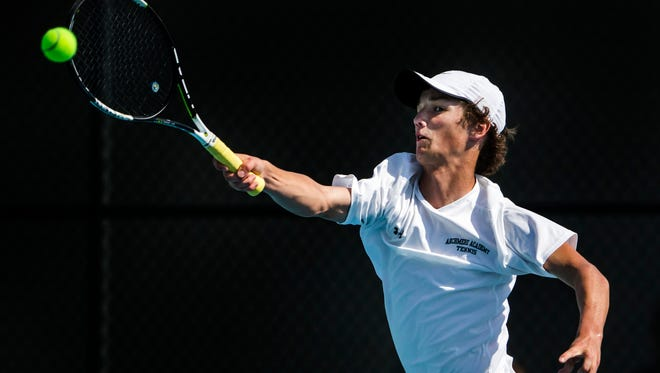 Archmere's Robby Ward returns a volley against Milford's Colt Williamson in the First Singles match of the DIAA Boys State Tennis Championship game at the University of Delaware in Newark on Thursday afternoon. Ward beat Williamson in straight sets, 6-4 and 6-4.