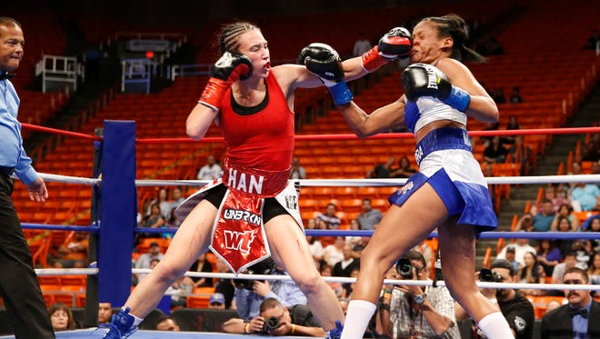 IBF World Featherweight Champion Jennifer Han connects to the face of opponent Liliana Martinez on Saturday night at the Don Haskins Center. Han would go on to retain her title with a 10 round unanimous decision.