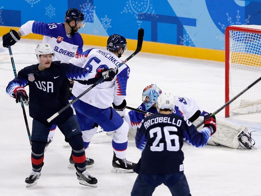Ryan Donato (16), of the United States, reacts as he scores a goal against Slovakia during the first period of the preliminary round of the men's hockey game at the 2018 Winter Olympics in Gangneung, South Korea, Friday, Feb. 16, 2018. (AP Photo/Frank Franklin II)