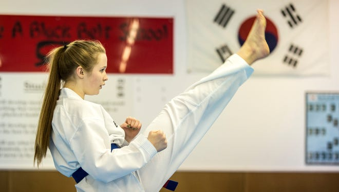 Clarissa Lademer, 13, of Port Huron, demonstrates a form at Port Huron Tae Kwon Do.