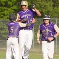 Fowlerville's Josh Bacha, (17), shown after a game-winning hit last year, gave the Gladiators more to celebrate on Wednesday with a grand slam that gave them the lead for good