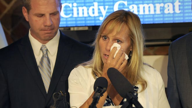 State Rep. Cindy Gamrat wipes away tears as husband Joe looks on during a news conference in East Lansing on Friday  where she apologized for an extramarital affair with fellow Rep. Todd Courser.
