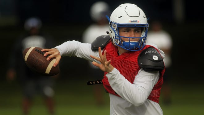 Godby quarterback Trey Fisher throws a pass during practice this week.