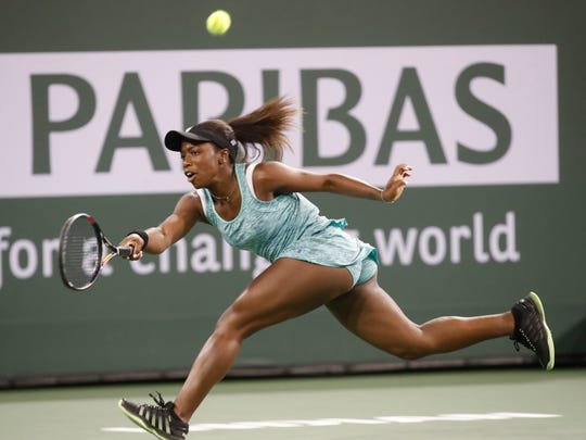 Sachia Vickery of the United States of America plays against Garbine Muguruza of Spain on Stadium 1 at the 2018 BNP Paribas Open at indian Wells Tennis Garden on March 9, 2018. Vickery won the match.