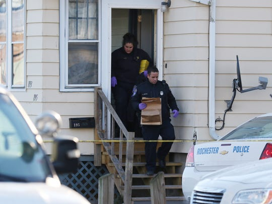 Police technicians carry out evidence during their investigation at 193-195 Leighton Ave. on January 11, 2016.