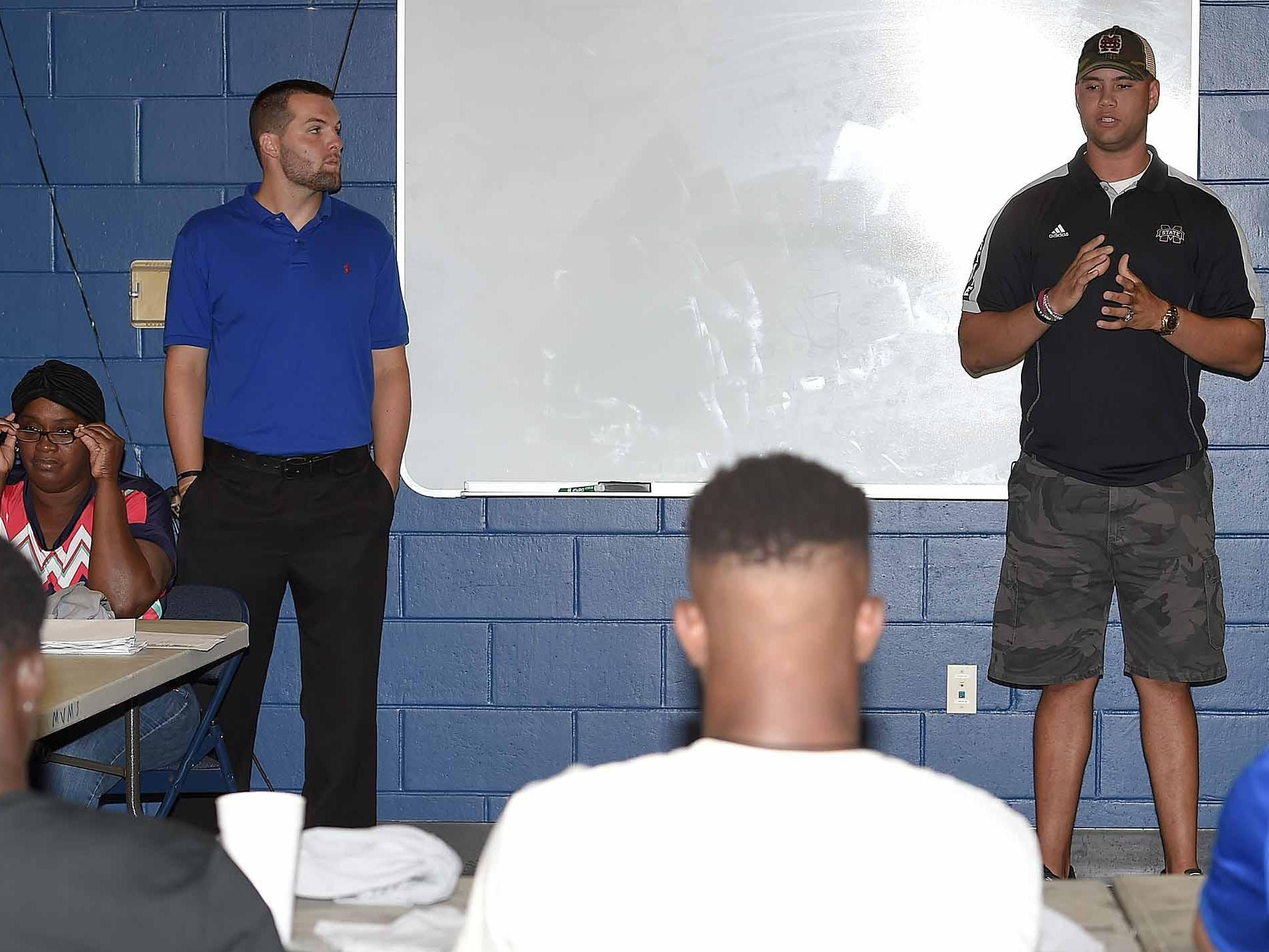 Tyler Russell (right) and Clayton Moore, quarterbacks in the 2008 Dandy Dozen, speak to the 2015 Dandy Dozen at Mississippi Veterans Memorial Stadium in Jackson on Tuesday.