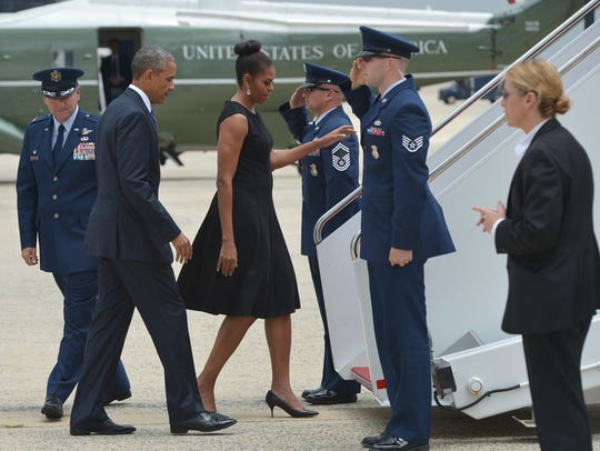 President Obama and First Lady Michelle Obama board