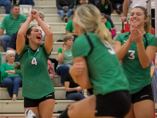 Yorktown celebrates a point during the first game of