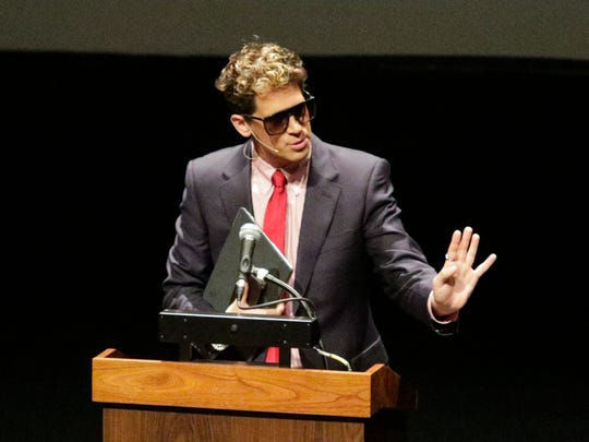 "Milo Yiannopoulos, the polarizing Breitbart News editor, speaks at California Polytechnic State University as part of his ""The Dangerous F----- Tour"" of college campuses, Tuesday, Jan. 31, 2017, in San Luis Obispo, Calif.  His speech was met with dozens of angry protesters outside a campus theater. (David Middlecamp/The Tribune (of San Luis Obispo) via AP)"