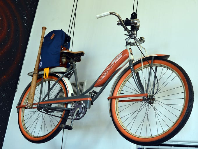 Vintage bikes hang from the ceiling at Beacon, including