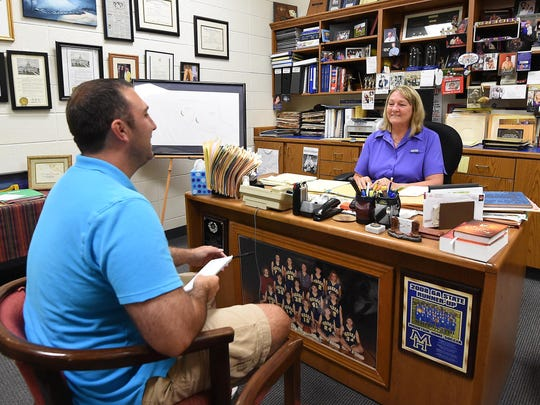 Bulletin sports reporter Neal Denton, left, and Janet Wood share a laugh during a recent interview.