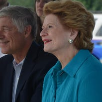 Col. Ron Wilson and Representative Fred Upton listen as Senator Debbie Stabenow answers a question.