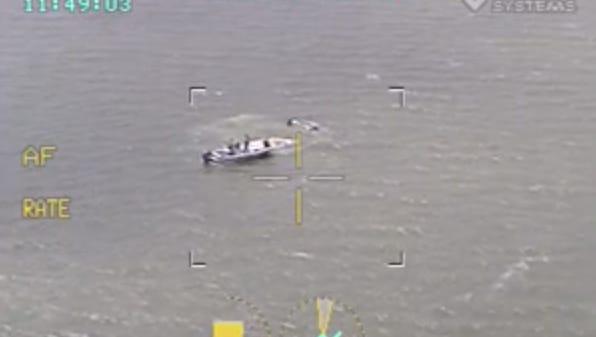 Brevard County Sheriff's Office took helicopter video during a rescue after a canoe overturned near Merritt Island.