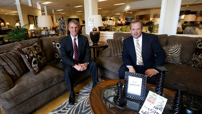 Austin Turner, left, and his brother Fortson Turner, at their Apalachee Parkway store, are the fourth generation to run the family-owned Turner furniture stores, which are celebrating their 100th anniversary.