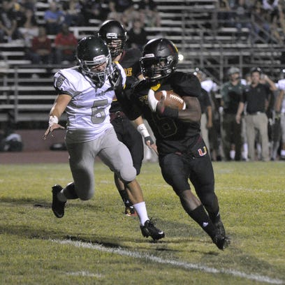 Tulare Union's Romello Harris rushed for 243 yards and three touchdowns in the Redskins' 35-19 win over Dinuba Friday at Bob Mathias Stadium.