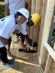 Tiarra and Jarvis Williams invest some sweat equity into their new Fairview home.